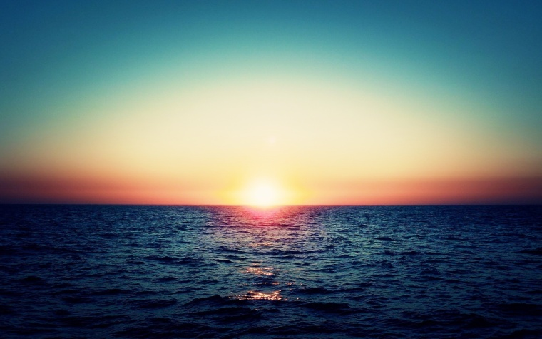 far_sunset_in_te_ocean_horizon-wide